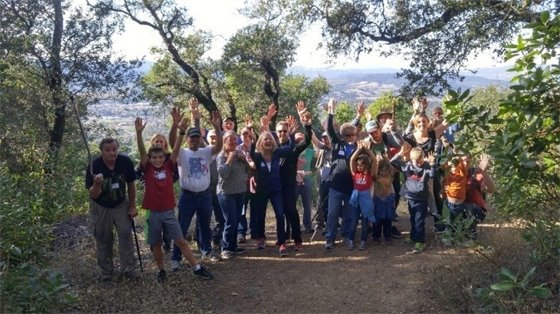 People raising their hands on a hike