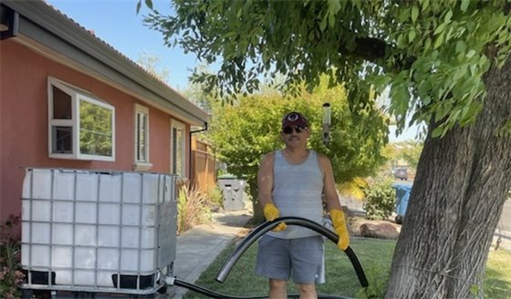 A gentleman delivering recycled water