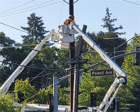 An electric lineman working on power lines