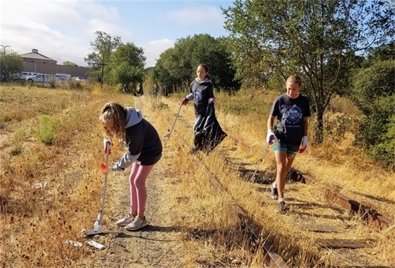Students picking up trash near Foss Creek