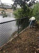 Repairing Fence at Railroad Park