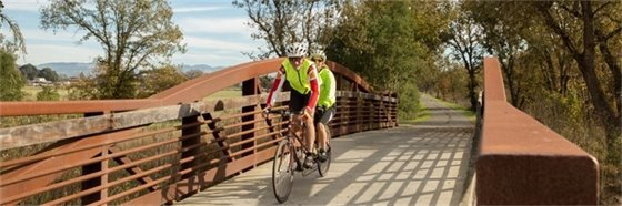 Santa Rosa couple riding bikes across bridge