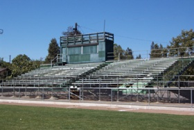 A grandstand next to an athletic field